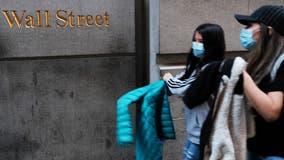 Stocks recoup most big losses as investors await virus aid