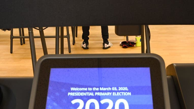 California voters cast their ballot on March 2, 2020 ahead of Super Tuesday during early voting for the California presidential primary election the YMCA in Burbank, California.