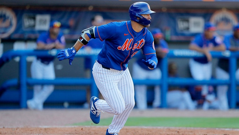 Tim Tebow runs out a ground ball out