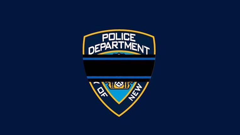 Black band across NYPD shield logo