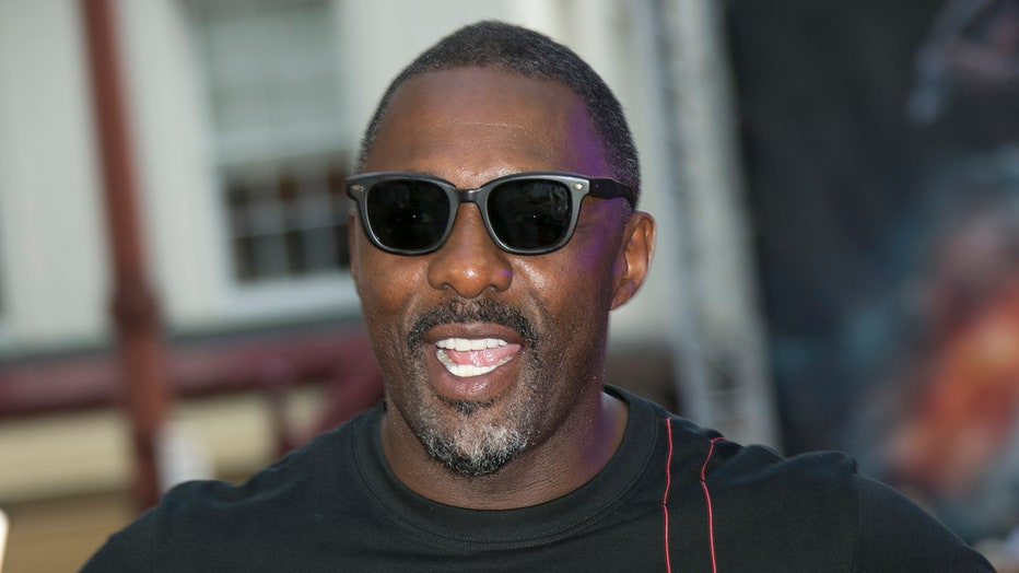 Actor Idris Elba smiling in central London