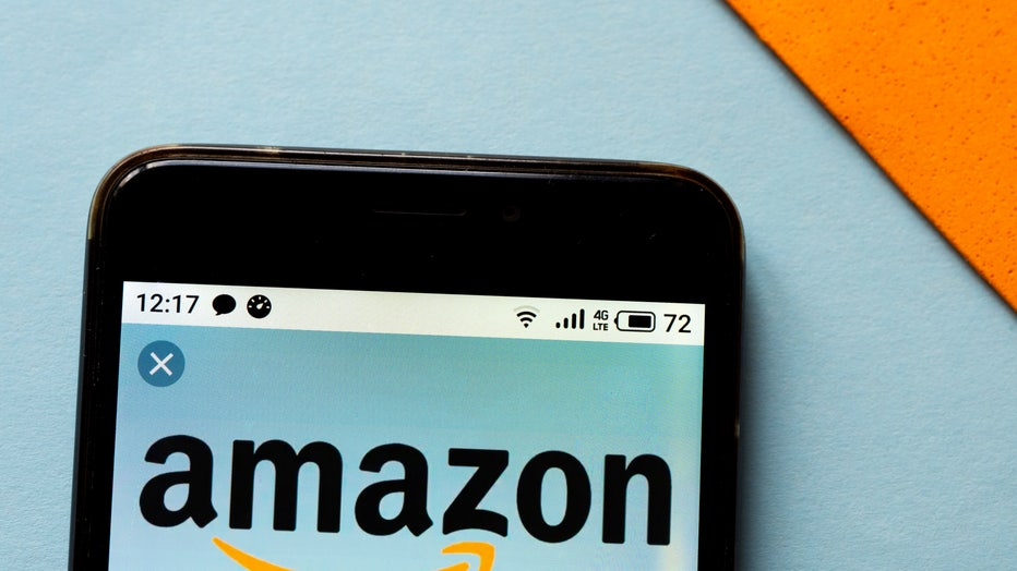 In this photo illustration an Amazon logo seen displayed on