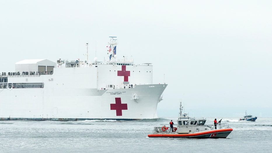Navy hospital ship, police boat and Coast Guard boat