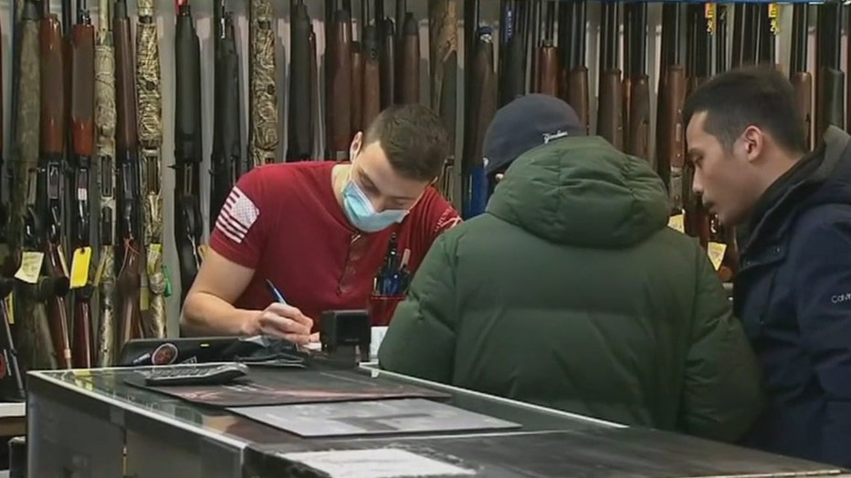 Shoppers at a gun store