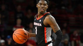 College basketball player charged with murder