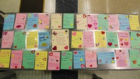 TSA officers make cards for COVID-19 patients and hospital workers