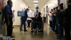 Hospital staff cheers as mom leaves hospital after beating COVID-19