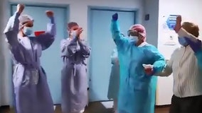 Medical staff cheers as 94-year-old woman gets discharged from Spanish hospital