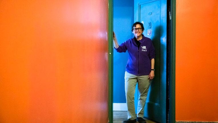 Rabbi Sharon Kleinbaum stands in the doorway of her apartment