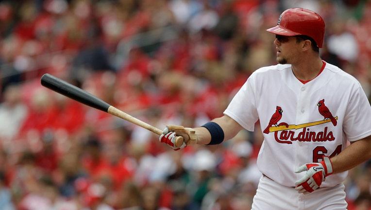 St. Louis Cardinals player Mark Hamilton in uniform holding a bat