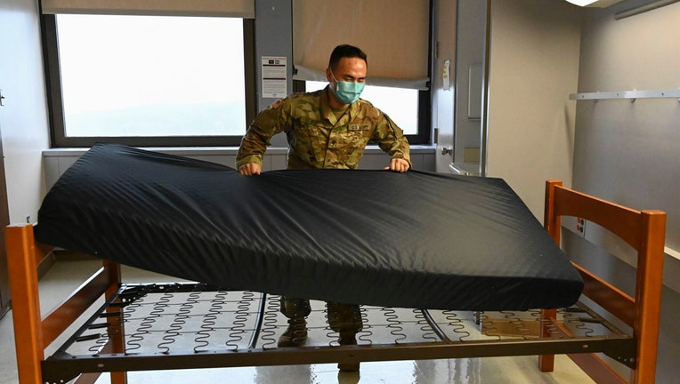 Soldier sets up a bed