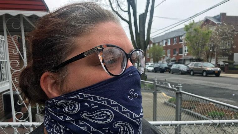 Woman wearing a blue and white bandana