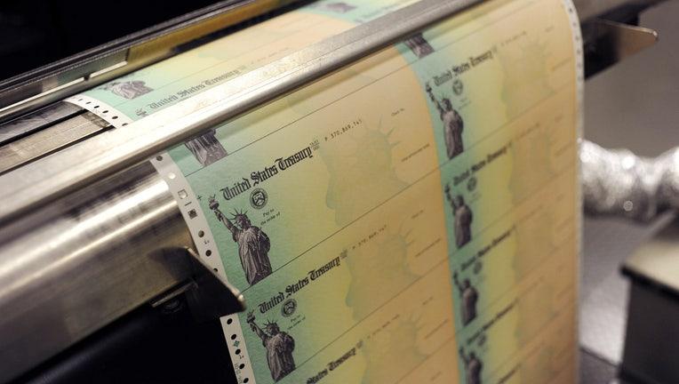 Blank U.S. Treasury checks run through a printer at the U.S. Treasury printing facility.