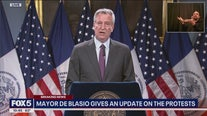 Mayor Bill de Blasio reacts to protests