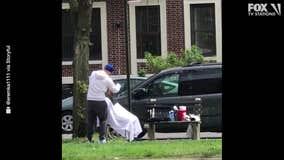 Barber defies lockdown to give haircuts on a Brooklyn sidewalk