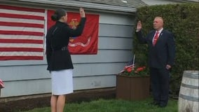 Amid canceled ceremonies, Marine officer commissioned from family's backyard