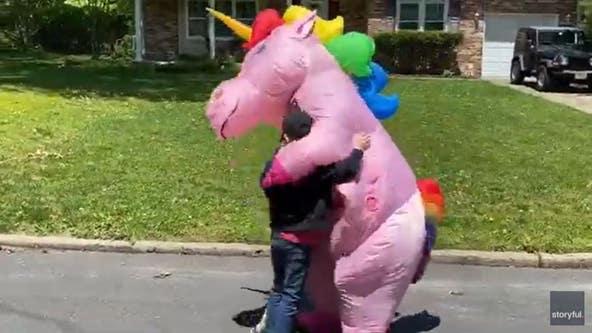 Grandma wears colorful unicorn costume to greet her grandkids amid pandemic