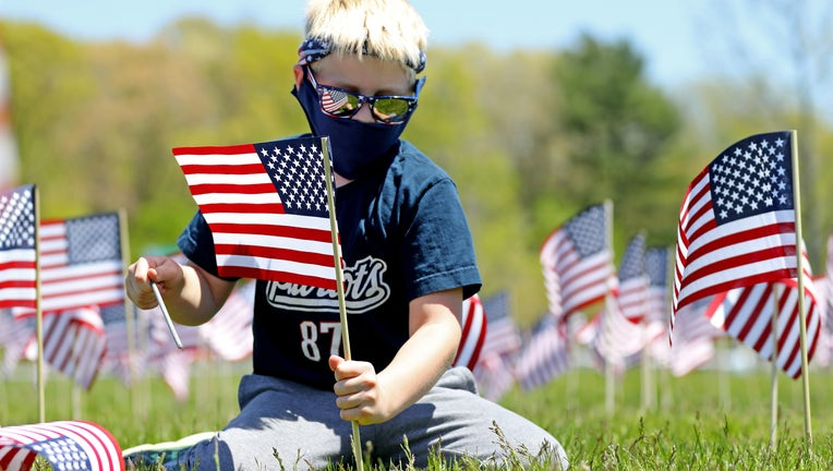 New England Patriots And Revolution Plant American Flags To Honor Veterans For Memorial Day