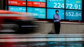 Stocks sink, reversing recent gains, as virus cases spike
