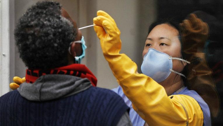 A nurse practitioner takes a swab sample testing for Coronavirus Covid-19.