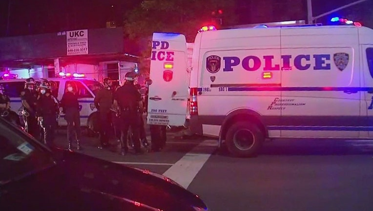NYPD officers and an NYPD van