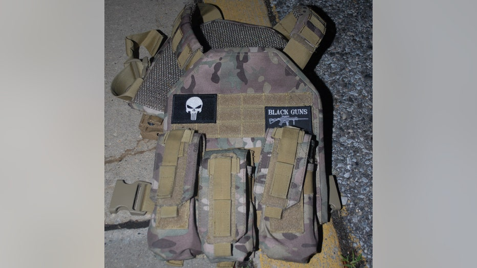 A camouflage-patterned tactical vest