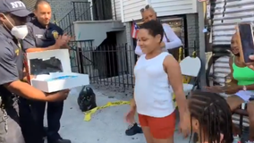 NYPD officers surprise Bronx girl whose home burned down with a cake for her birthday