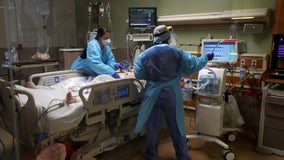 Doctors and nurses have to battle virus... and skeptics