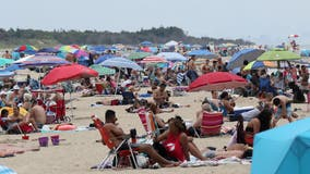 Virus concerns grow as huge crowds flood Jersey Shore for July 4 weekend