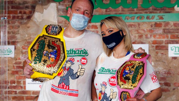 Hot dog champs repeat as NYC marks virus-dampened July 4