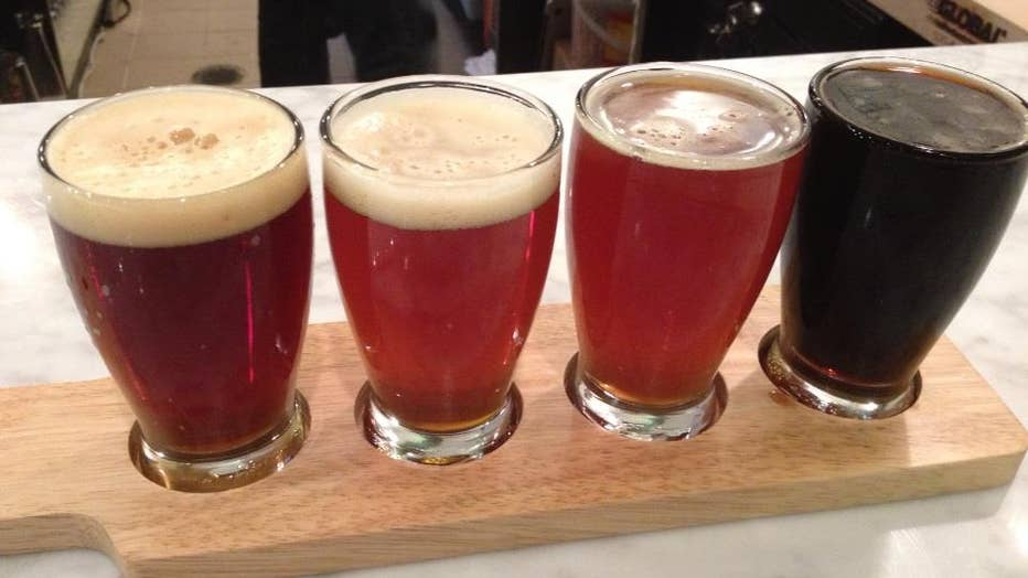 A flight of 4 glasses of beer