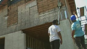 Teenagers volunteer to help rebuild home for Superstorm Sandy victim