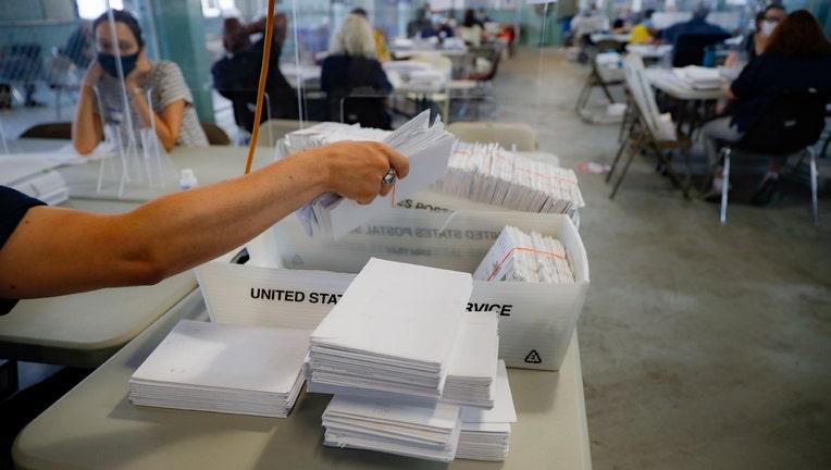 Postal working sorting mail