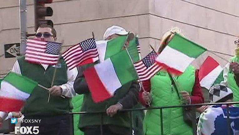 Parade participants waving U.S. and Italian flags