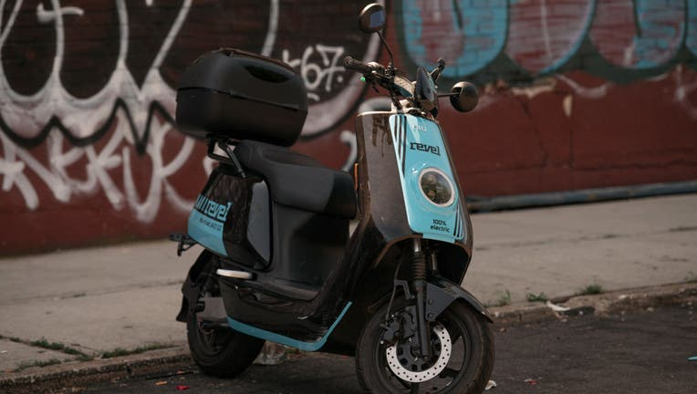 FILE - A Revel moped sits unused on the street on July 28, 2020 in Brooklyn. (Photo by Scott Heins/Getty Images)