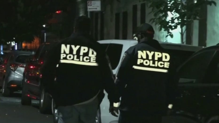 Police officers wearing jackets with the lettering NYPD Police