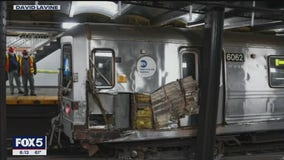 Subway train hits debris and derails