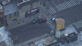 Car slams into T-Mobile store in Manhattan