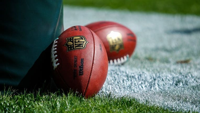 Footballs lay against the goal-post prior to the NFL game.