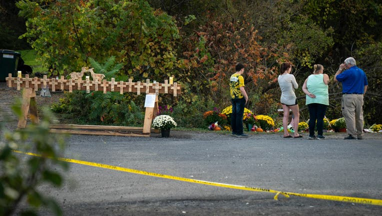 Mourners visit the site of a fatal limousine crash that killed 20 people near the intersection of Route 30 South and Route 30A, October 10, 2018 in Schoharie, New York.