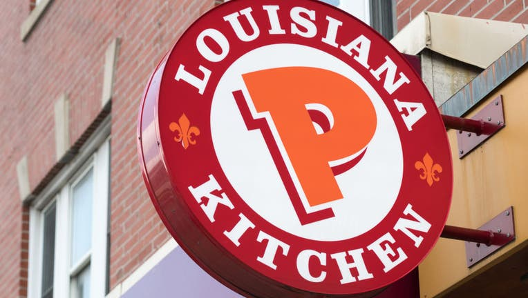 Popeyes Lousiana Kitchen sing or logo outside a restaurant