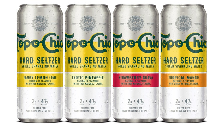 4 cans of hard seltzer; the cans are silver with yellow, orange and red variations