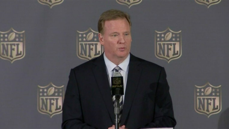 Roger Goodell speaks into a microphone