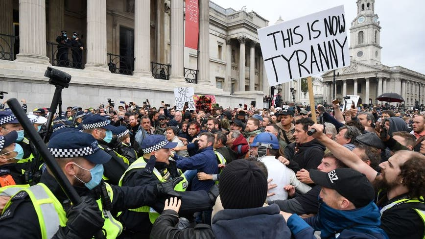 Police clash with thousands as demonstrators protest against COVID-19 restrictions in UK