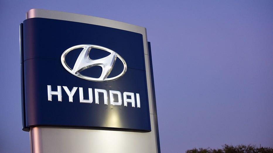 afee0797-A sign is seen at a Hyundai car dealership. Hyundai and Kia
