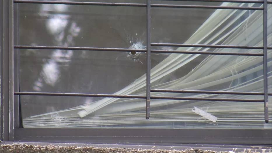 A woman was killed by a random bullet that went through the window of her 7th floor apartment.