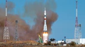 Russian, American crew reach space station using a fast-track maneuver