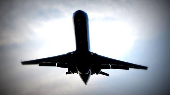 Woman died of coronavirus during flight
