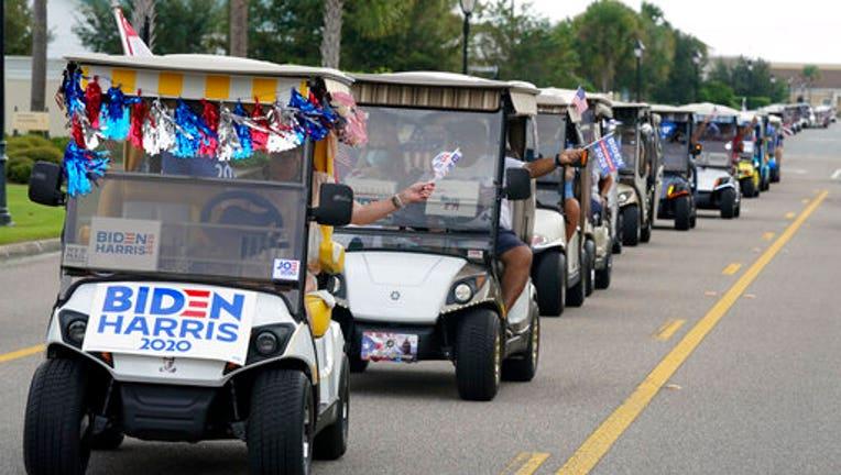 A parade of golf carts supporting Joe Biden.