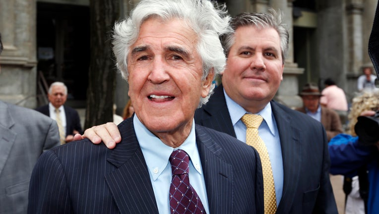 Former state Senator Joseph Bruno, left, and his son Ken Bruno walk away from the federal courthouse after a jury found him not guilty of federal fraud charges on Friday, May 16, 2014, in Albany, N.Y.